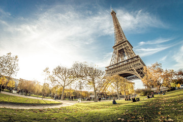 Autumn sun setting by the Eiffel Tower.