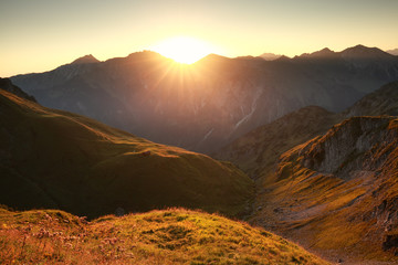 golden sunrise in mountains