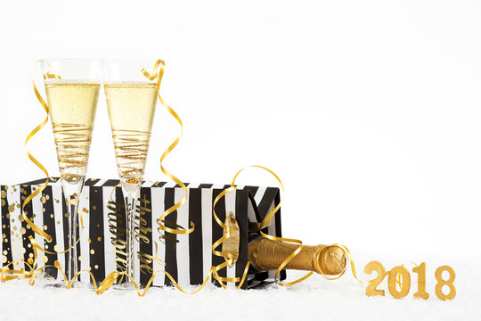 New Year Celebration with Champagne Glasses 2018. Let there be bubbles bottle and flutes with bubbling champagne on white background.