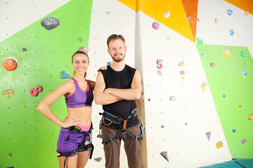 Young couple in climbing gym