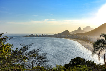 View from top of Copacabana beach with the hills and mountains of Rio de Janeiro in the background