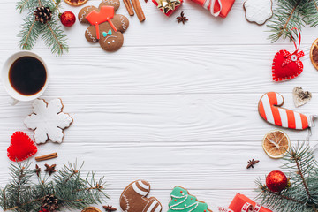 Homemade delicious Christmas gingerbread cookies on the white wooden background.