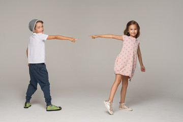 Happy dancing kids. Studio photo.