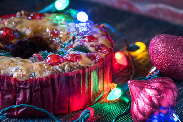 Christmas fruitcake with festive lights