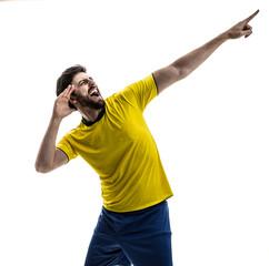 Male athlete / fan celebrating in yellow uniform on white background