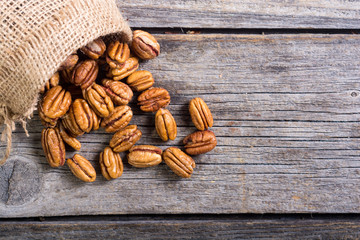 Pecan nuts in burlap bag
