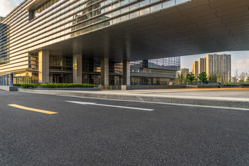 empty road and modern office buildings at dusk