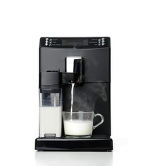 Espresso and americano coffee machine maker steaming milk for a latte or cappuccino preparation process