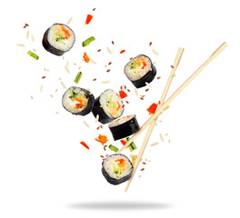 Pieces of sushi frozen in the air isolated on white background
