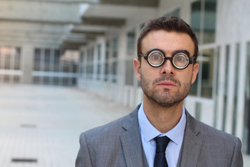 Businessman wearing thick glasses isolated