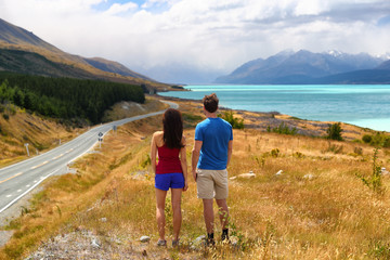Wall Mural - New Zealand travel nature couple tourists looking at view of Aoraki/Mount Cook at Peter's lookout, famous tourist destination.