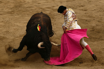 Venezuelan bullfighter Jose Enrique Colombo performs a pass to a bull during a bullfight at Peru's historic Plaza de Acho bullring in Lima