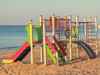 Bright and colorful children's Playground on the ocean.