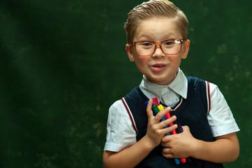 Positive school boy holding felt pens