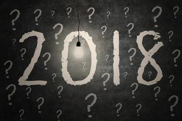 Bright light bulb illuminate the numbers 2018