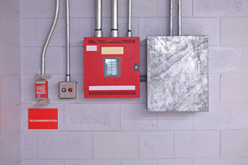 fire alarm switch on wall. Electrical Conduit & PVC Conduit
