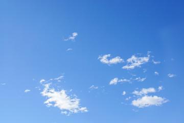 deep blue sky with tiny clouds