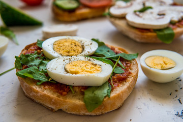 Sandwiches for breakfast. Ciabatta with arugula and egg