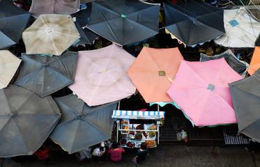 sunshade, food counter at outdoor market