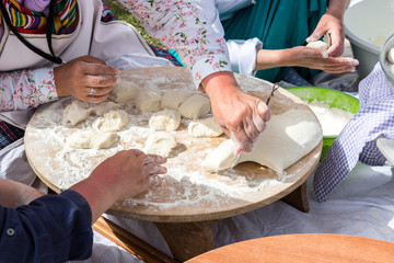 Woman Prepare traditional Turkish yufka for pastries