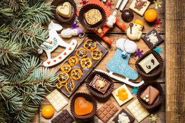 chocolate sweets, chocolates with Christmas symbols, toys, tree