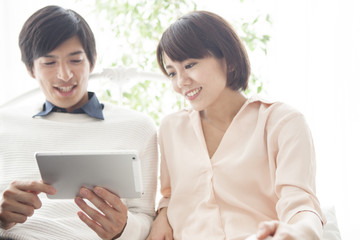 A couple is using a tablet terminal.