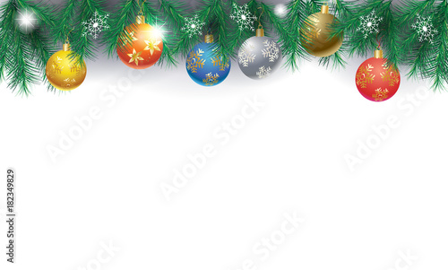 border of fir twigs decorated with colorful christmas baubles balls on white background with large