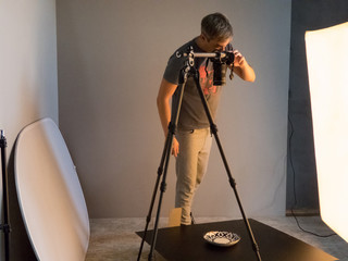 the photographer fills the order in the studio. unintended photography