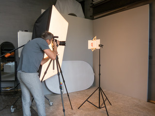 a young man working in the photo studio. unintended photography