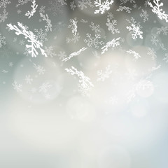 Winter background with a falling snowflakes