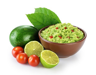Guacamole and ingredients isolated on white background.