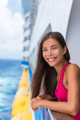 Wall Mural - Happy travel woman on cruise vacation smiling at her Caribbean or Europe holidays ahead of her. Summer holiday. Asian girl enjoying ocean view of balcony of her luxury suite in the ship.