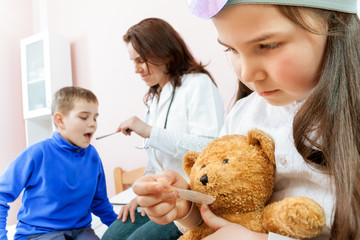 Doctor examining a child in a doctors office