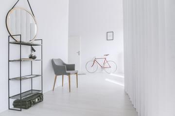 Grey chair in minimalist corridor