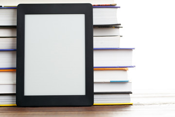 Image of blank black picture frame near stack of books