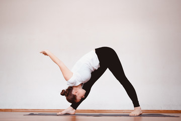 Yoga Concept. Close up woman meditates while practicing yoga in training hall or home.