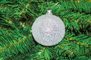 Decorative crystal ball on the Christmas tree. White ball decoration hanging on Christmas tree.