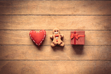 Christmas gingerbread man with heart shape toy and gift box