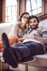 Young couple paying attention to TV