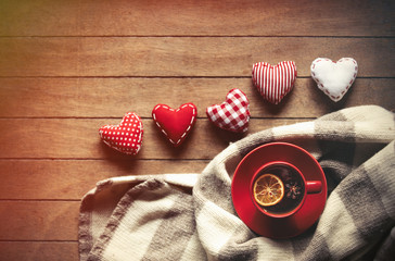 Cup of tea and scarf with heart shapes