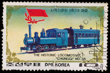 Samara, Russia - November 25, 2017: Old postage stamp printed in DPR Korea, shows historic locomotive chunggi and railroad