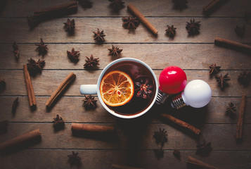 Cup of tea with lemon near cinnamon nad star anise, bulbs