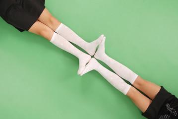Two girls in knee-length socks