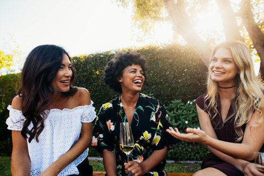Happy young female friends at outdoors party