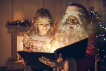 Girl with Santa Claus
