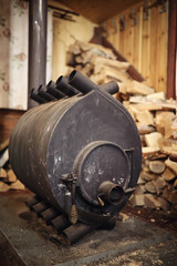 Wood burning stove. Firewood for furnace heating. Warehouse for