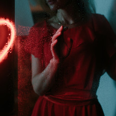 Mystic woman behind rainy window