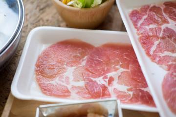 Sliced pork and vegetables in hot pot