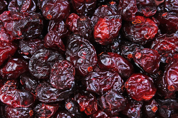 Raisins as background Grape Raisin texture. Red cranberry mullberry raisin dry fruit as texture pattern studio background