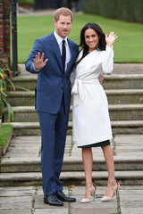 Britain's Prince Harry poses with Meghan Markle in the Sunken Garden of Kensington Palace, London
